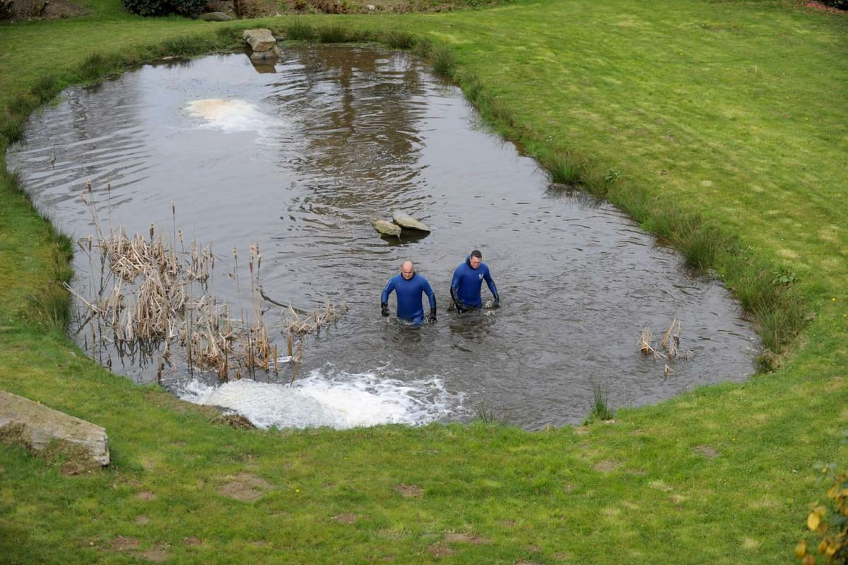 Gendarmes search in a pond ss part of the research for the Troadec family, missing since February 16, on March 2, 2017 near Dirinon, western France. The Troadec family -- Pascal and Brigitte, both aged 49, their son Sebastien, 21, and his sister Char