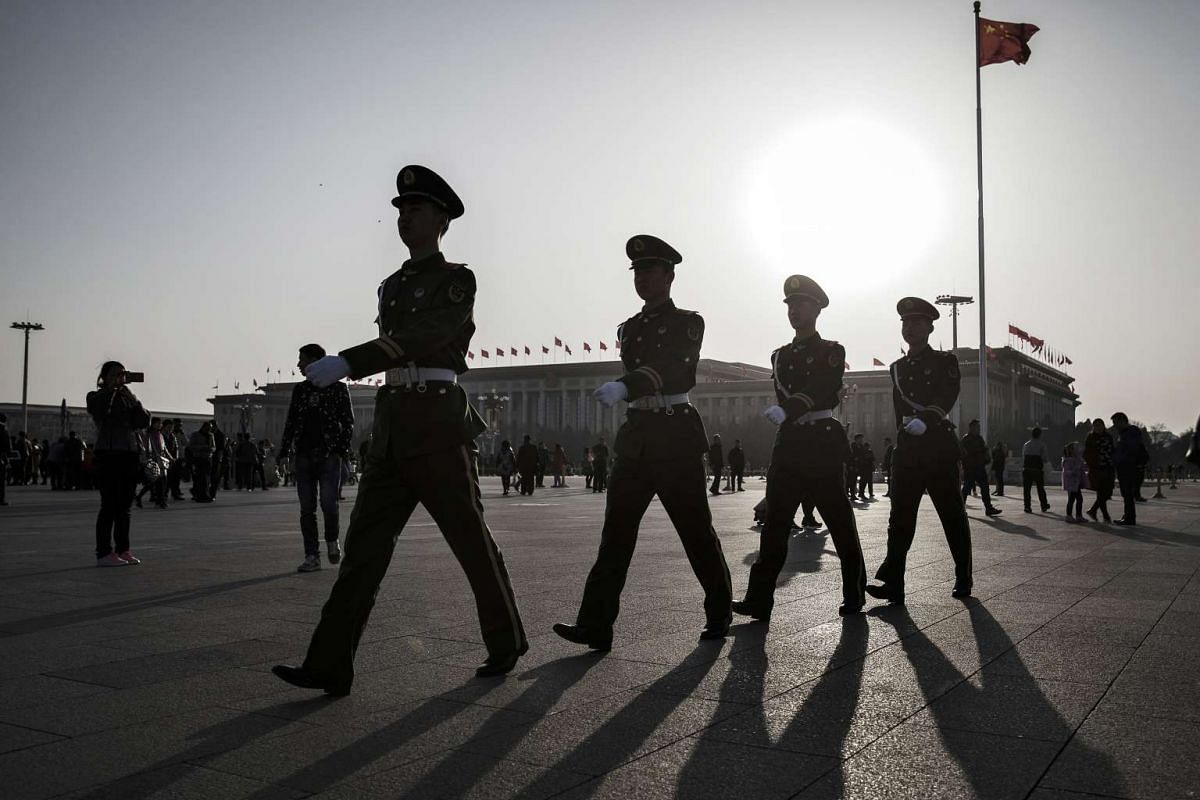 Members of the Chinese People's Armed Police march through Tiananmen Square in Beijing, China, on Thursday, March 2, 2017. As 3,000 lawmakers from across China descend on Beijing for an annual meeting of the world's largest legislature, President Xi