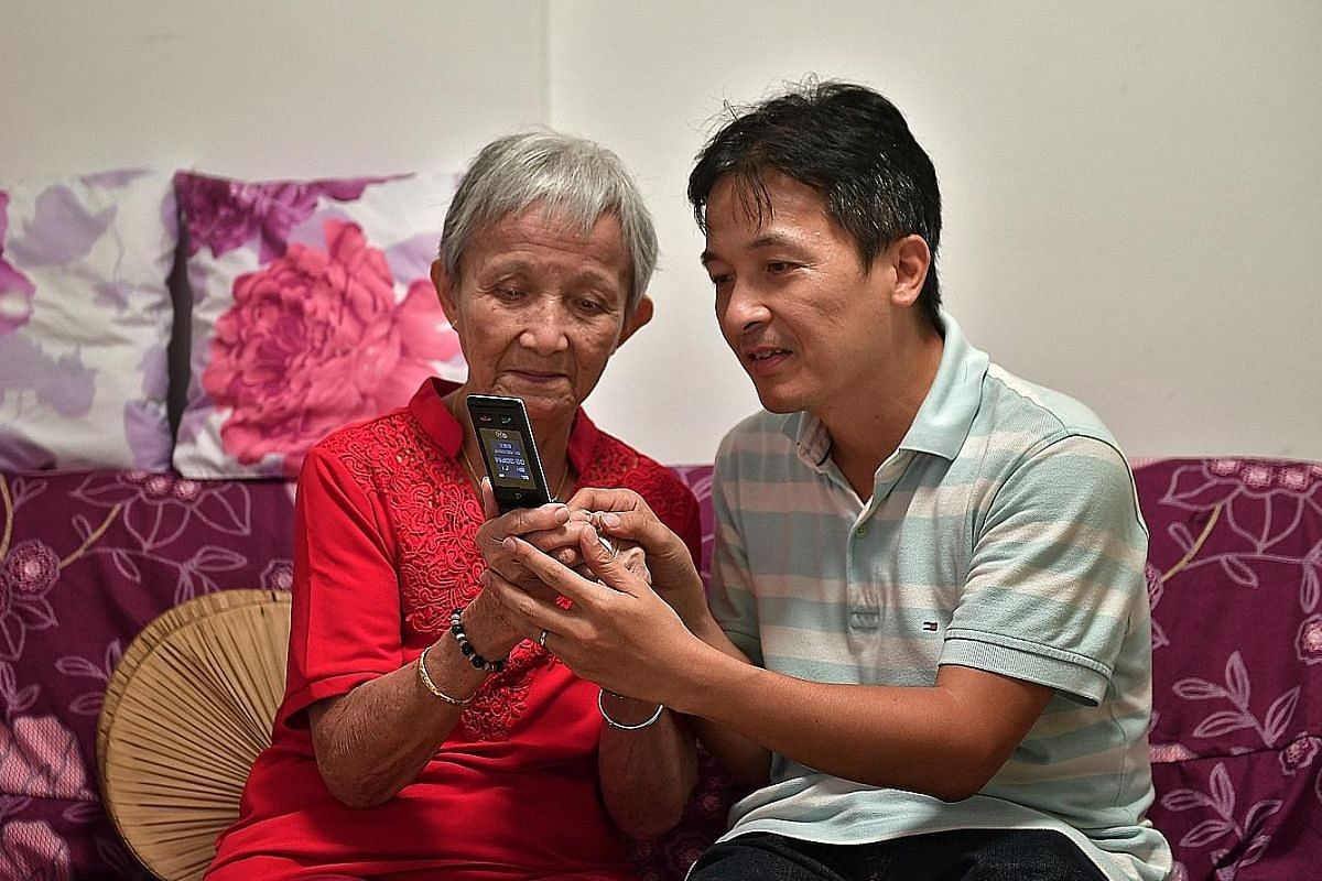 Retiree Ong Ah Tee relies on her son Danny Toh (both above) to teach her how to use a 3G phone.