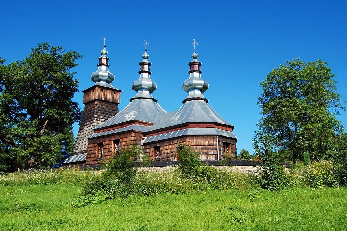 The Orthodox Church in Berest (above) is a stop along the Wooden Architecture Route around Krynica, which showcases beautiful wooden churches. The Nikifor Museum (below) in a 19th-century wooden building in Krynica-Zdroj houses the works of Nikifor,