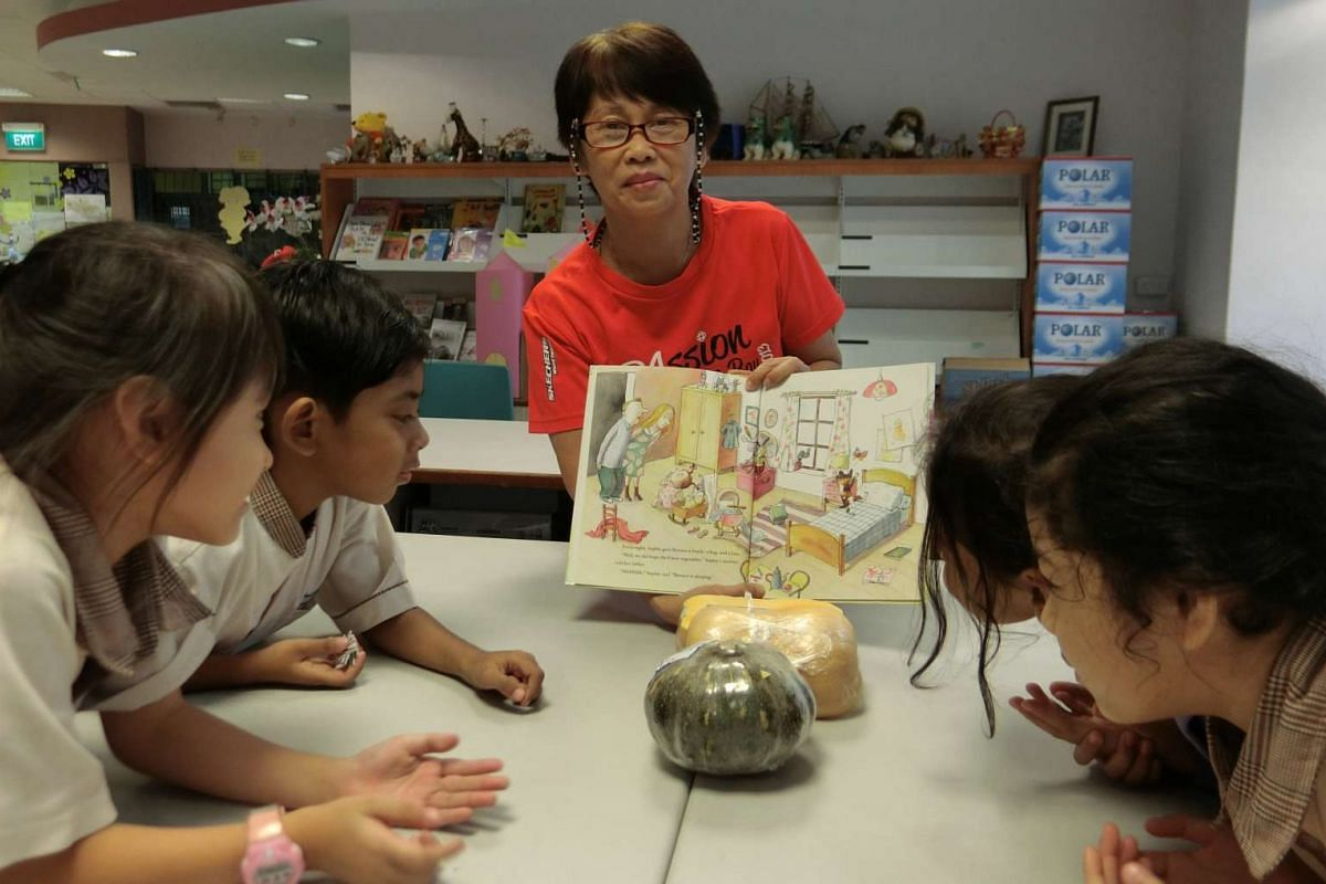 Parent volunteer Jenny Wee at a volunteer reading session for Primary 1 and 2 children at Fuhua Primary School.