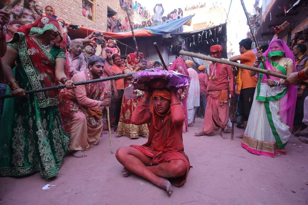 Indian women beat men with sticks, during the annual Lathmar Holi festival in Barsana village, Mathura, India, March 6, 2017. In Barsana, people celebrate a variation of holi, called 'Lathmar' Holi, which means 'beating with sticks'. During the Lathm