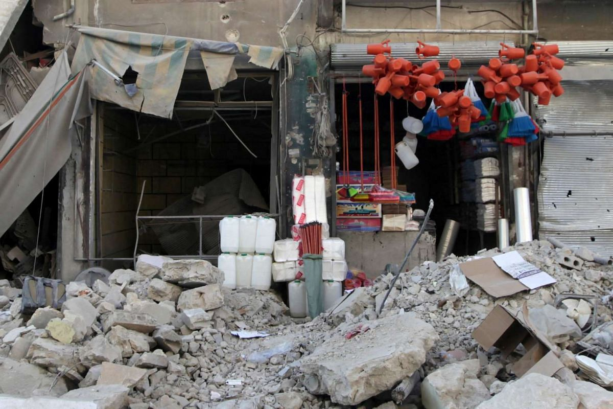 A shop displays its merchandise amid the damage in the northern Syrian town of al-Bab, Syria March 6, 2017.