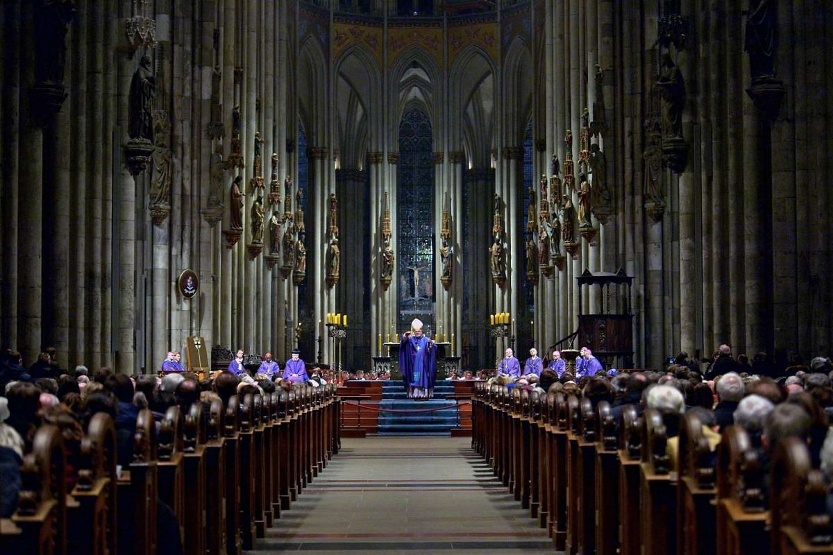 Cardinal Reinhard Marx, chairman of the German Bishops' Conference, leads a mass during the opening ceremony of the annual general meeting in the Cathedral in Cologne, Germany, March 6, 2017. The members of the conference that includes diocesan bisho
