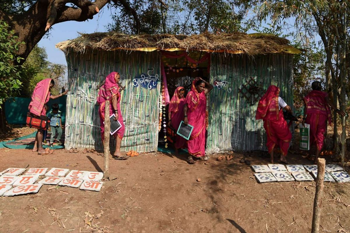 """Women leaving a class at Aajibaichi Shala, or """"school for grannies"""" in the local Marathi language, in Phangane village in Maharashtra state's Thane district, some 125km northeast of Mumbai. Deprived of an education as children, the women -- most of w"""