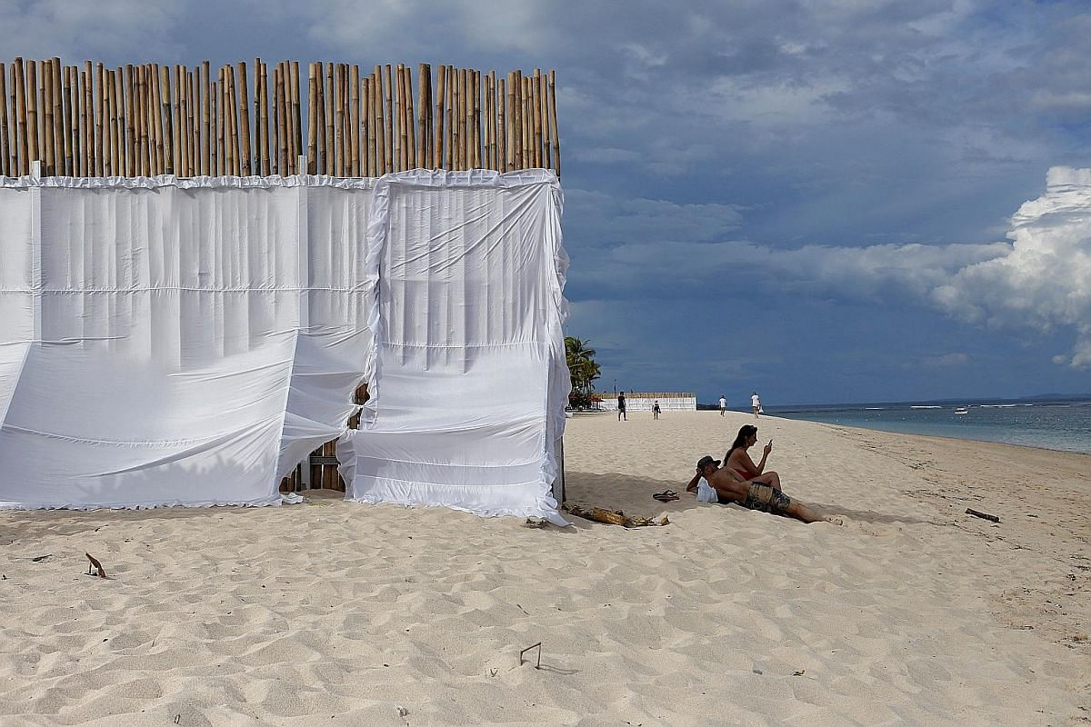 A privacy wall is erected on the beach next to St Regis Hotel. King Salman's visit to Indonesia includes an extended holiday in Bali. Nude statues at the Bogor state palace are covered up as a mark of respect for King Salman and his entourage. Rows o