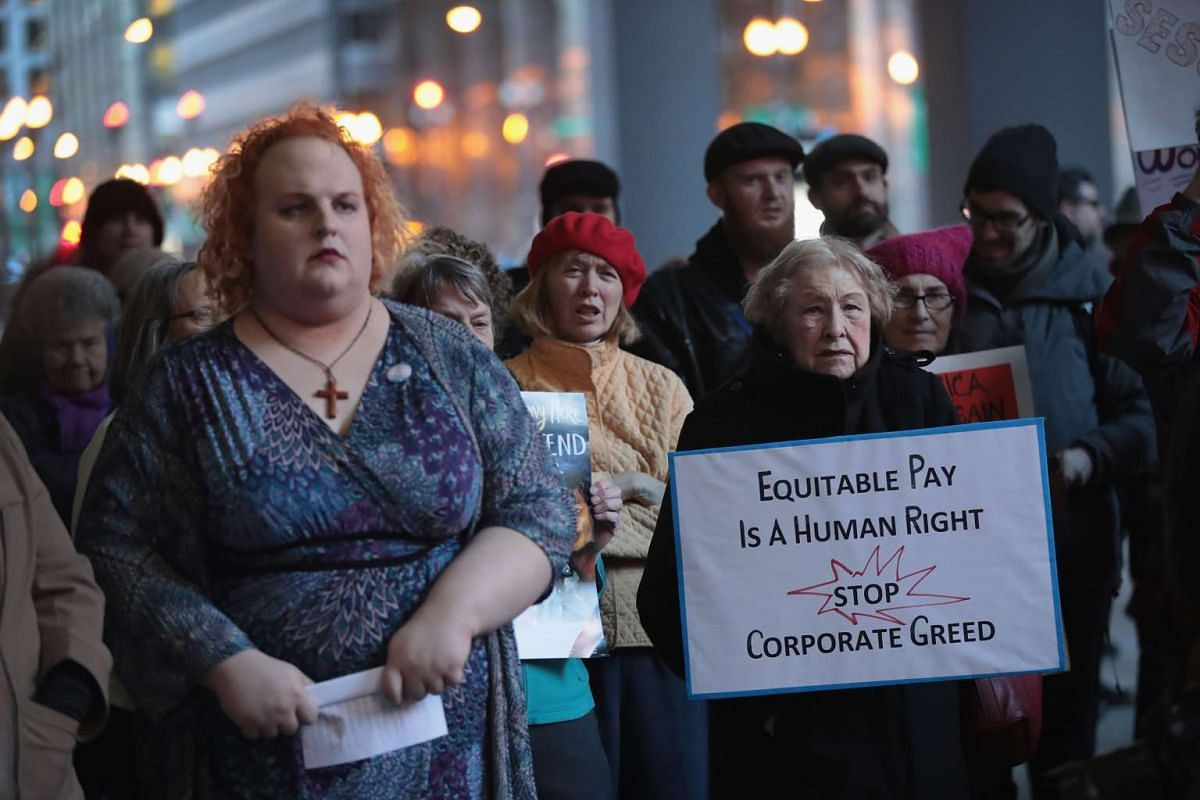 Demonstrators at a march to support International Women's Day and to protest against the administration of US President Donald Trump on Tuesday (March 7) in Chicago. The demonstrators have vowed to protest every Tuesday for the first 100 days of the
