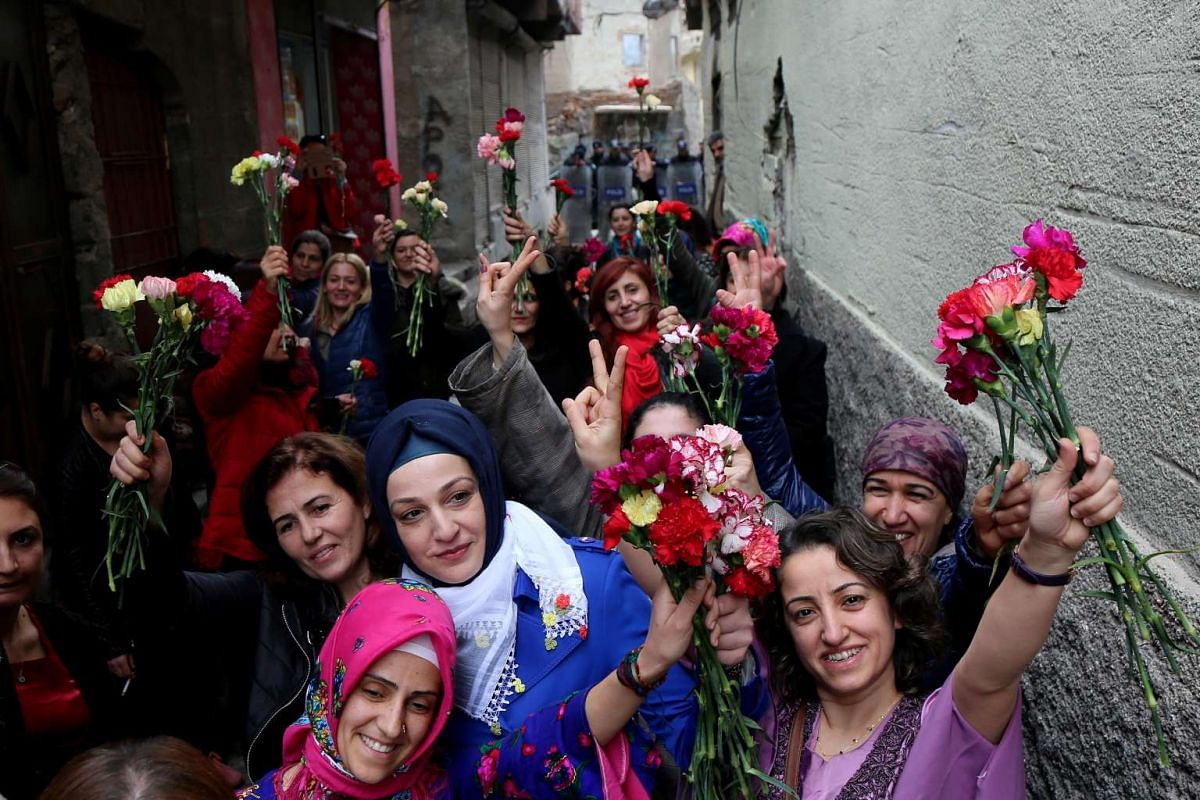 Activists gather in the historical Sur district to promote an International Women's Day rally on Wednesday (March 8) in the Kurdish-dominated south-eastern city of Diyarbakir in Turkey.