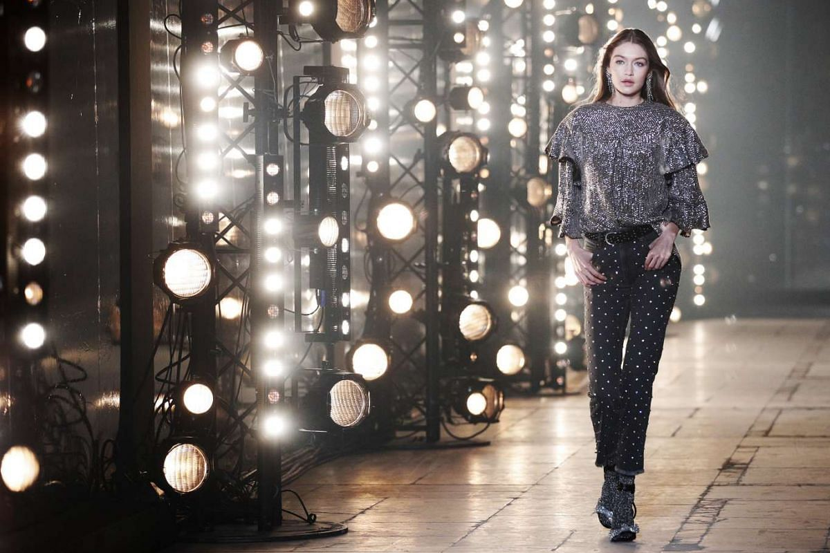 Model Gigi Hadid presents a creation from the Fall/Winter 2017/18 ready-to-wear collection by French designer Isabel Marant.