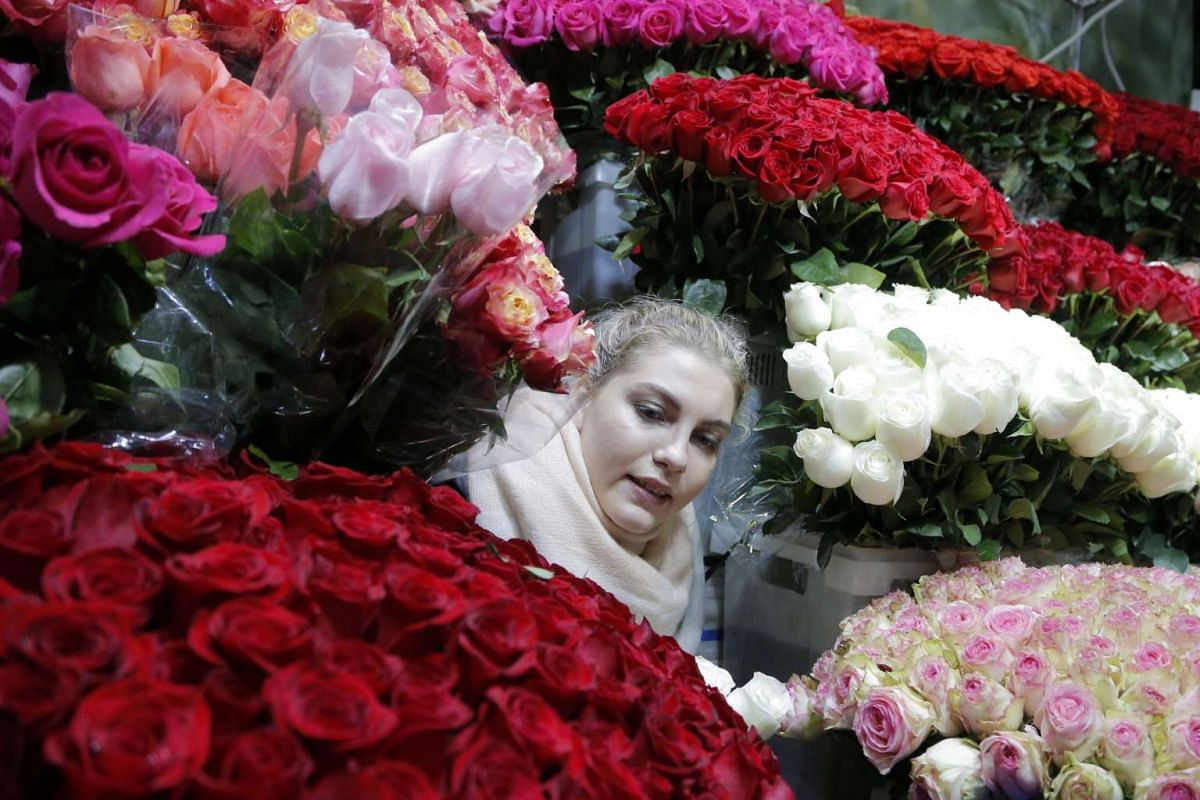 A flower seller at Rizhsky flower market in downtown Moscow. International Women's Day is a well-loved holiday in the country as Russian women receive flowers, cards and other gifts.