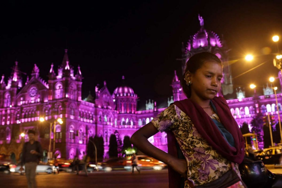 Unesco World Heritage Site Chhatrapati Shivaji Maharaj Terminus railway station in Mumbai, India, is lit up with pink lights on Tuesday (March 7).