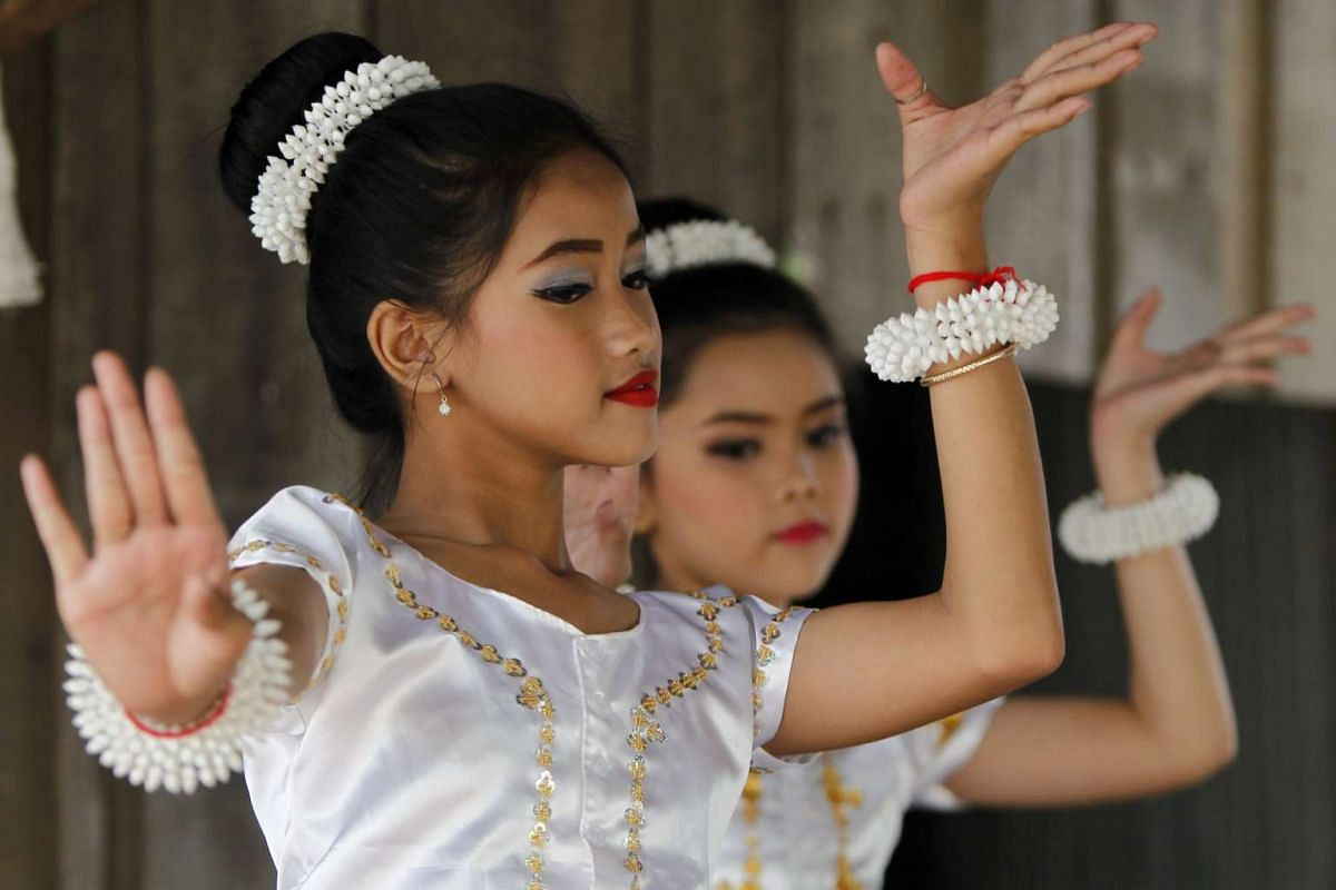 Dancers perform at an event in Phnom Penh, Cambodia, on Tuesday (March 6) where land rights activists gathered to defy a ban by City Hall for an International Women's Day celebration for garment factory workers.