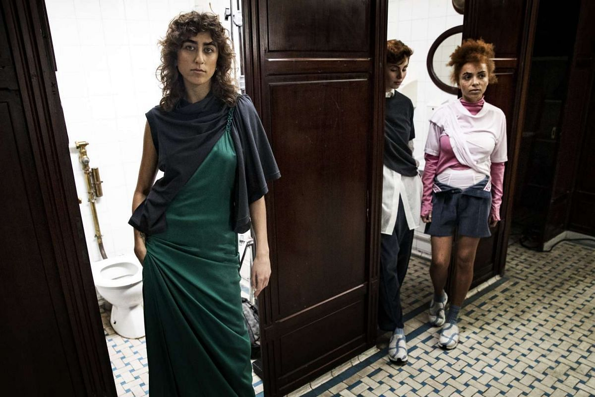 Models revealed Sirloin's debut collection by opening the mahogany cubicle doors of the historic Madeleine public toilets in central Paris.