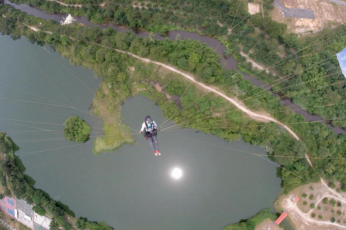 Mr Christopher Hsieh, a design manager, flying over Kuala Kubu Baru in Selangor, Malaysia on Sept 11, 2016 . The avid paraglider travels to nearby countries to fly once every fortnight.