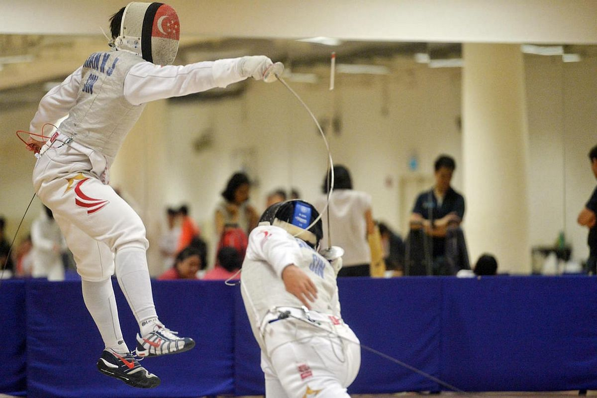 Kevin Chan (left) of Hwa Chong Institution facing off with Nicholas Choong of Catholic Junior College at a foil event held at the OCBC Arena, Singapore Sports Hub, on March 28, 2016.