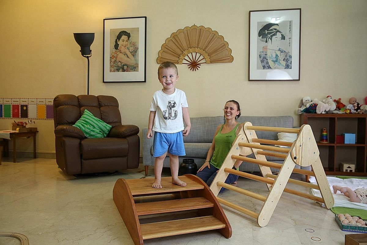 Ms Kasia Poleszak- Langner with her son, Franek, on the bespoke step climber. The other climbing structure is a Pikler Triangle, which was also custom-made.