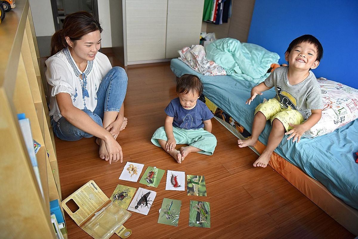 Stay-at-home mother Yang Jingyi believes in encouraging independence in her sons, Evan (centre) and Emmanuel.