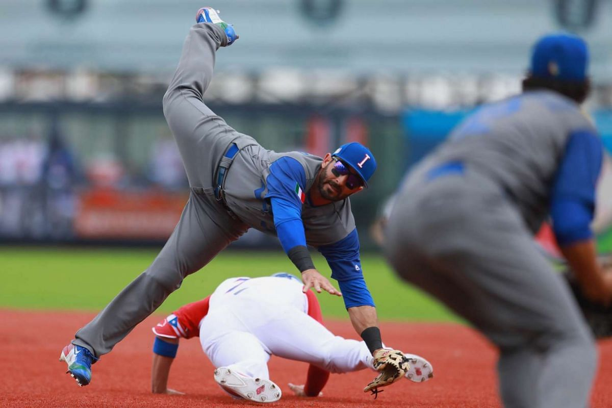 Daniel Descalso #3 of Italy tries to tags out Enrique Hernandez #7 of Puerto Rico in the bottom of the second inning during the World Baseball Classic Pool D Game 5 between Italy and Puerto Rico at Panamericano Stadium on March 12, 2017 in Zapopan, M