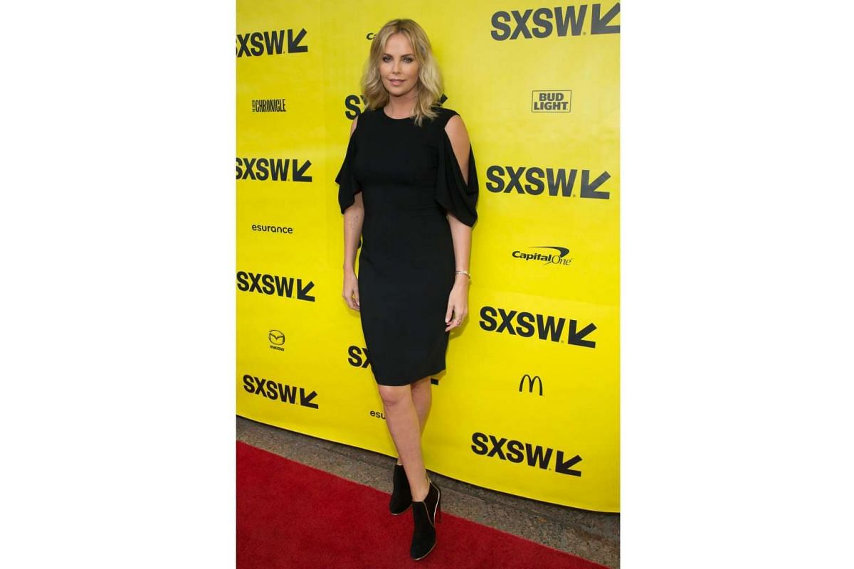 Actress Charlize Theron arrives for the premiere of the film Atomic Blonde during The South by Southwest (SXSW) Film Conference held at the Paramount Theater on March 12, 2017 in Austin, Texas.