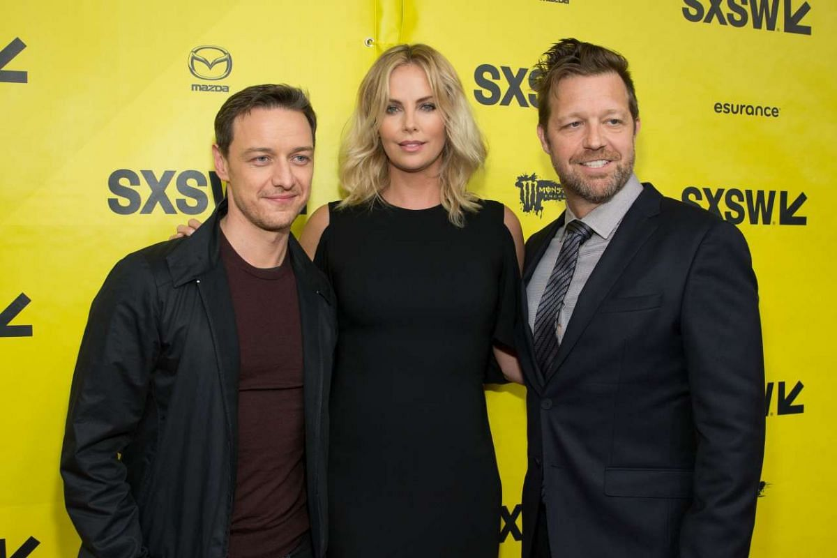 (From left) Actors James McAvoy, Charlize Theron and director David Leitch arrive for the premiere of the film Atomic Blonde during The South by Southwest (SXSW) Film Conference held at the Paramount Theater on March 12, 2017 in Austin, Texas.