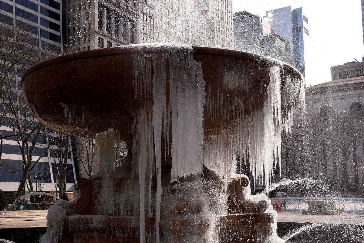 The Josephine Shaw Lowell Memorial Fountain in Bryant Park is covered in ice on March 13, 2017 as the weather continues to be below freezing.