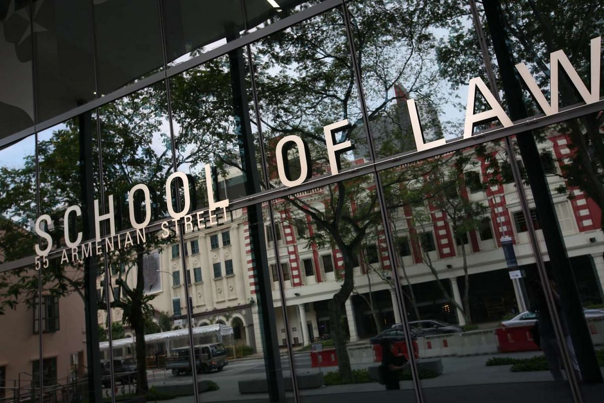 The glass door at the main entrance of SMU's School of Law.