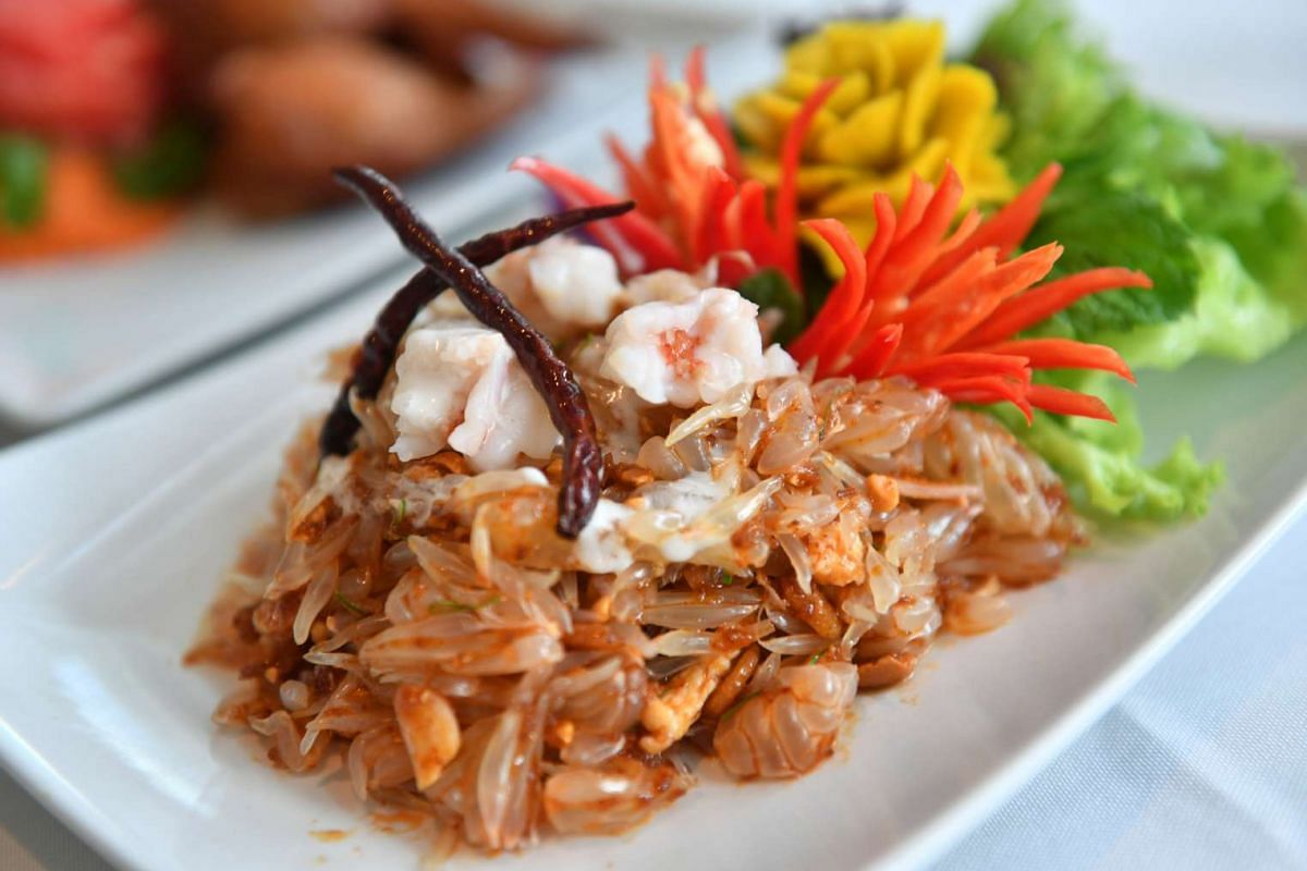 Spicy pomelo salad with prawns, chicken, roasted coconut, grounded peanuts, chili jam and sweet sauce from Sabai Fine Thai On The Bay.