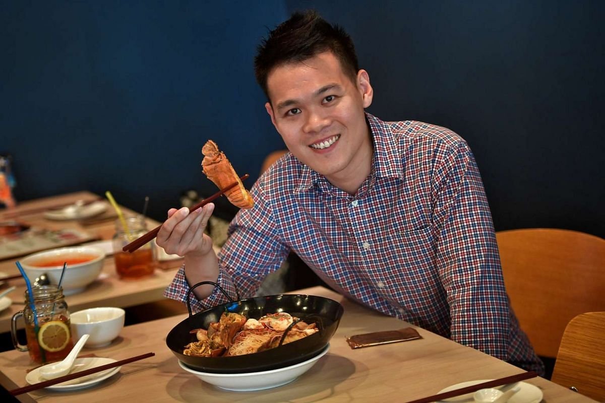 """Mr Cedric Chng, owner of zi char restaurant Big Lazy Chop, with its signature """"Indo"""" Curry Combo Beehoon, which comes with crayfish."""