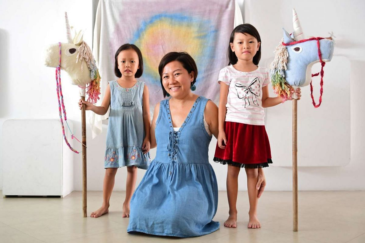 Housewife Doreene Ng, who has made toys such as Waldorf dolls and a chick on a boat using natural materials for her daughters Celeste (far left) and Arianna.