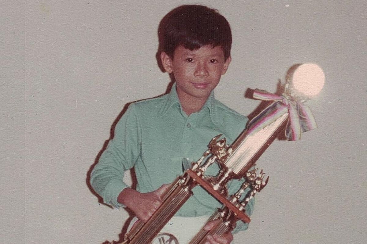 My life so far: Goh Kheng Long celebrating his wife Tay Ting Ting's birthday with Hong Kong pop star Jacky Cheung in January; and Goh, aged 11 (above), when he won the Yamaha Electone Competition in 1978.