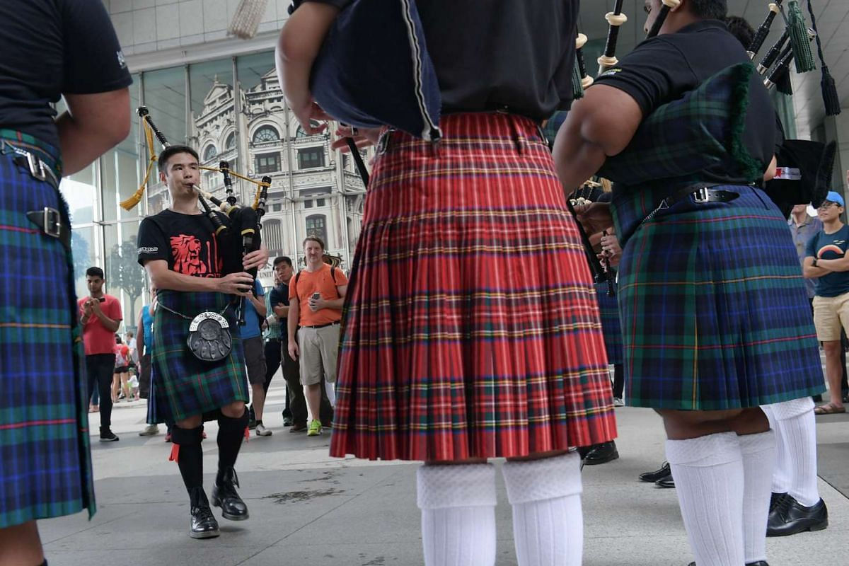 Joshua Ang, 30, from the Lion City pipe band, performs with his band at the St. Patrick's Day street festival on March 19, 2017.
