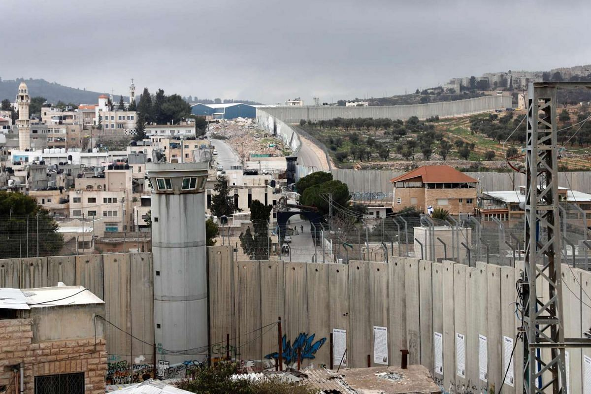 A picture taken from the window of one of the rooms at the Walled-Off Hotel shows Israel's controversial separation wall.
