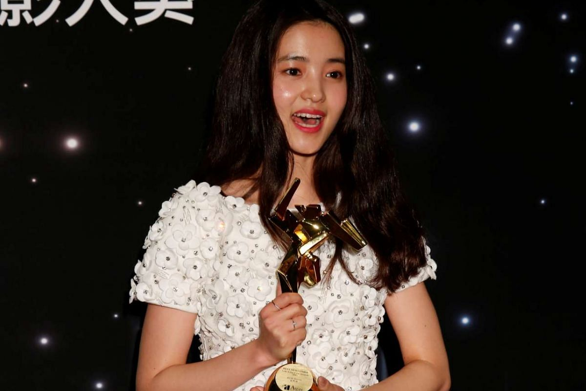 South Korean actress Kim Tae-ri celebrates after winning the Best Newcomer award at the Asian Film Awards in Hong Kong on March 21, 2017.