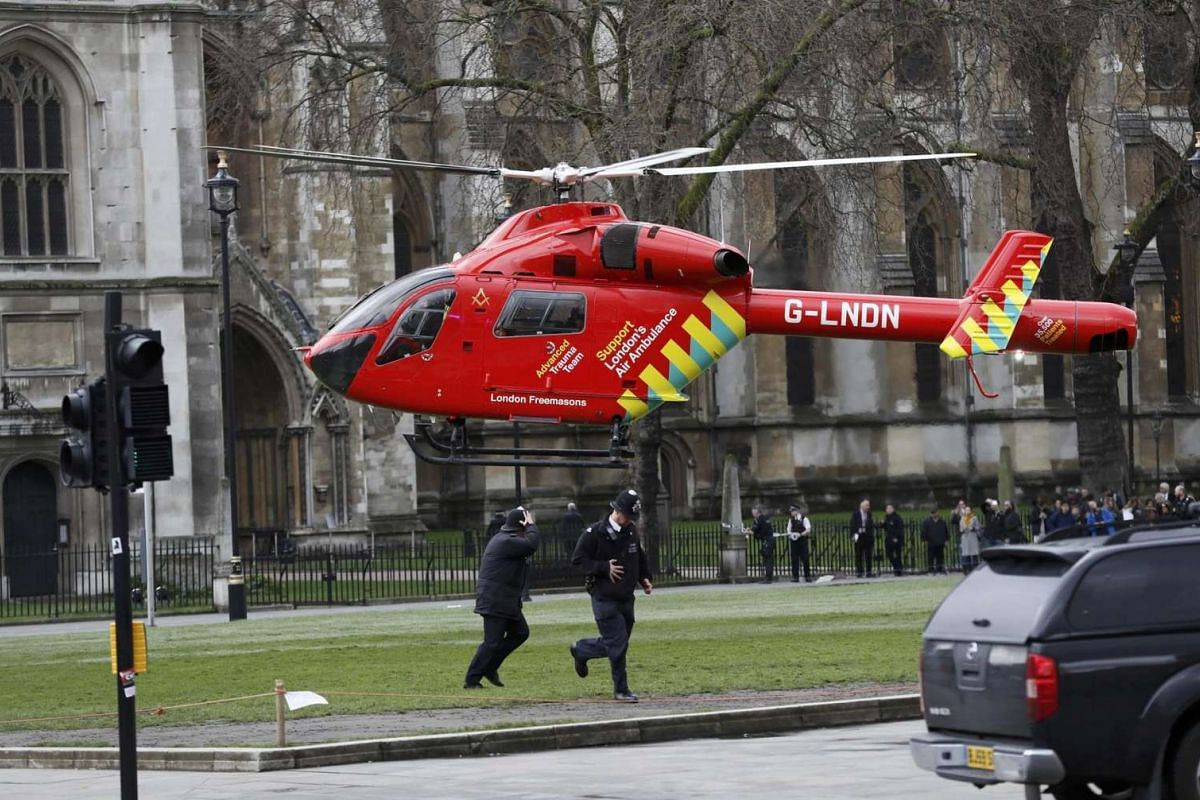 An air ambulance lands in Parliament Square during an incident on Westminster Bridge in London on March 22, 2017.