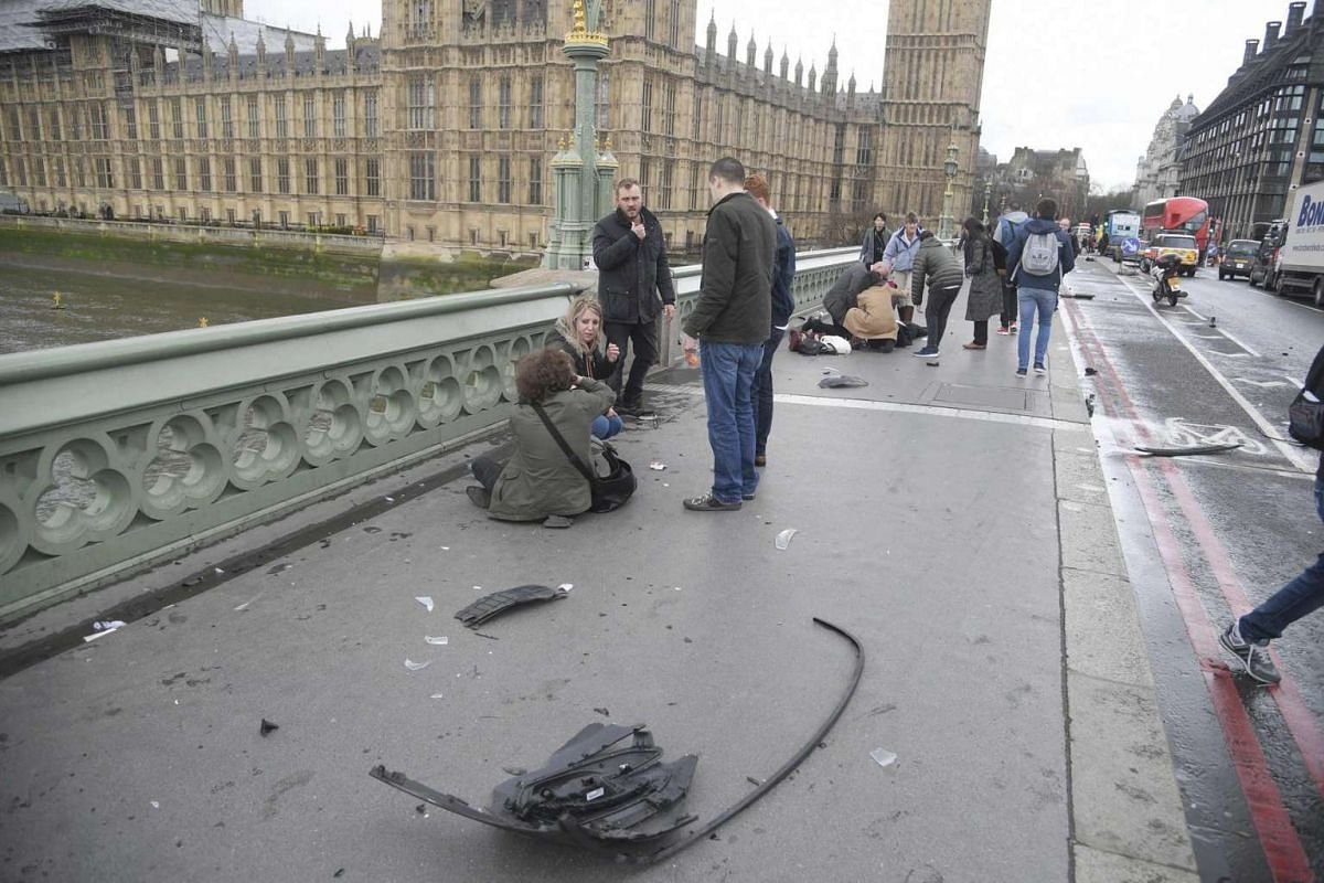 An injured person being attended to after the incident on Westminster Bridge in London, March 22, 2017.