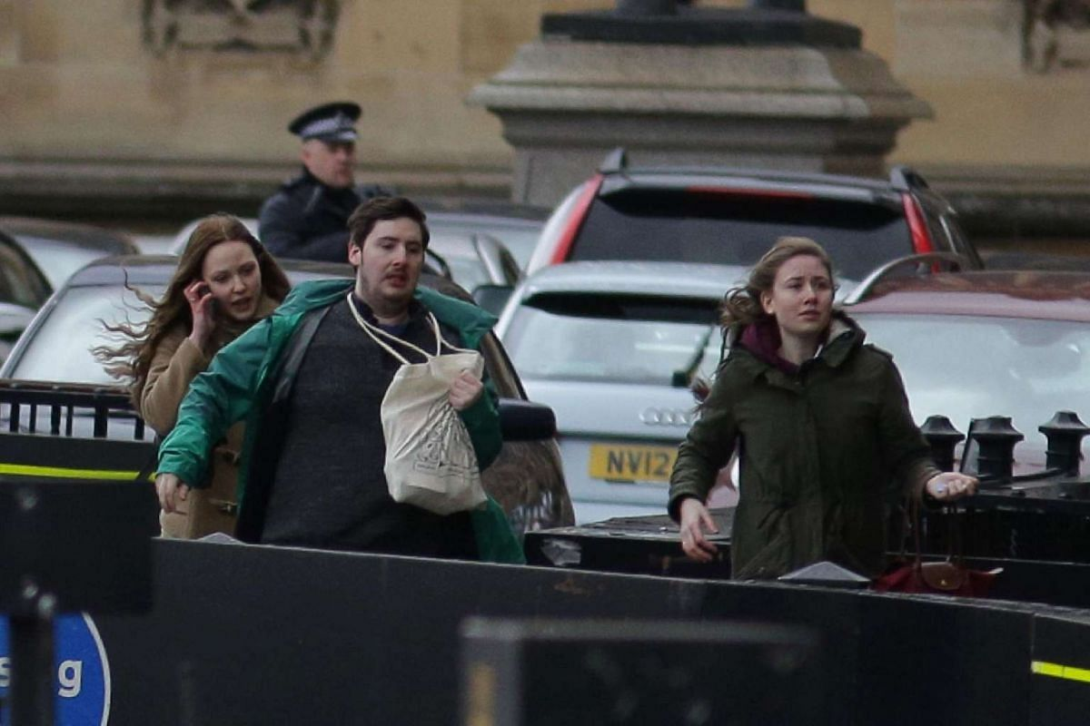 People leave after being evacuated from the Houses of Parliament in central London on March 22, 2017, during the incident.
