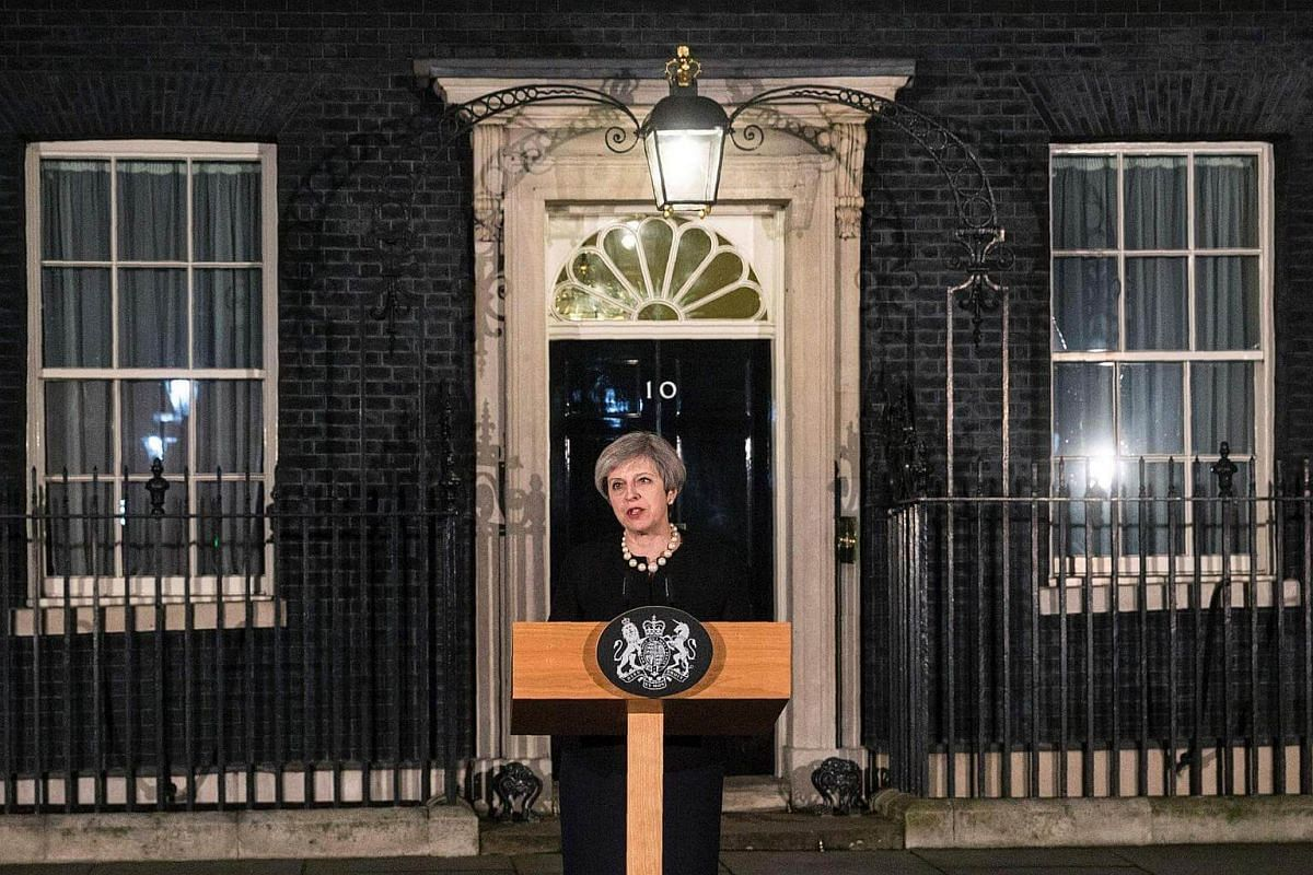 British Prime Minister Theresa May speaks outside 10 Downing Street in central London.
