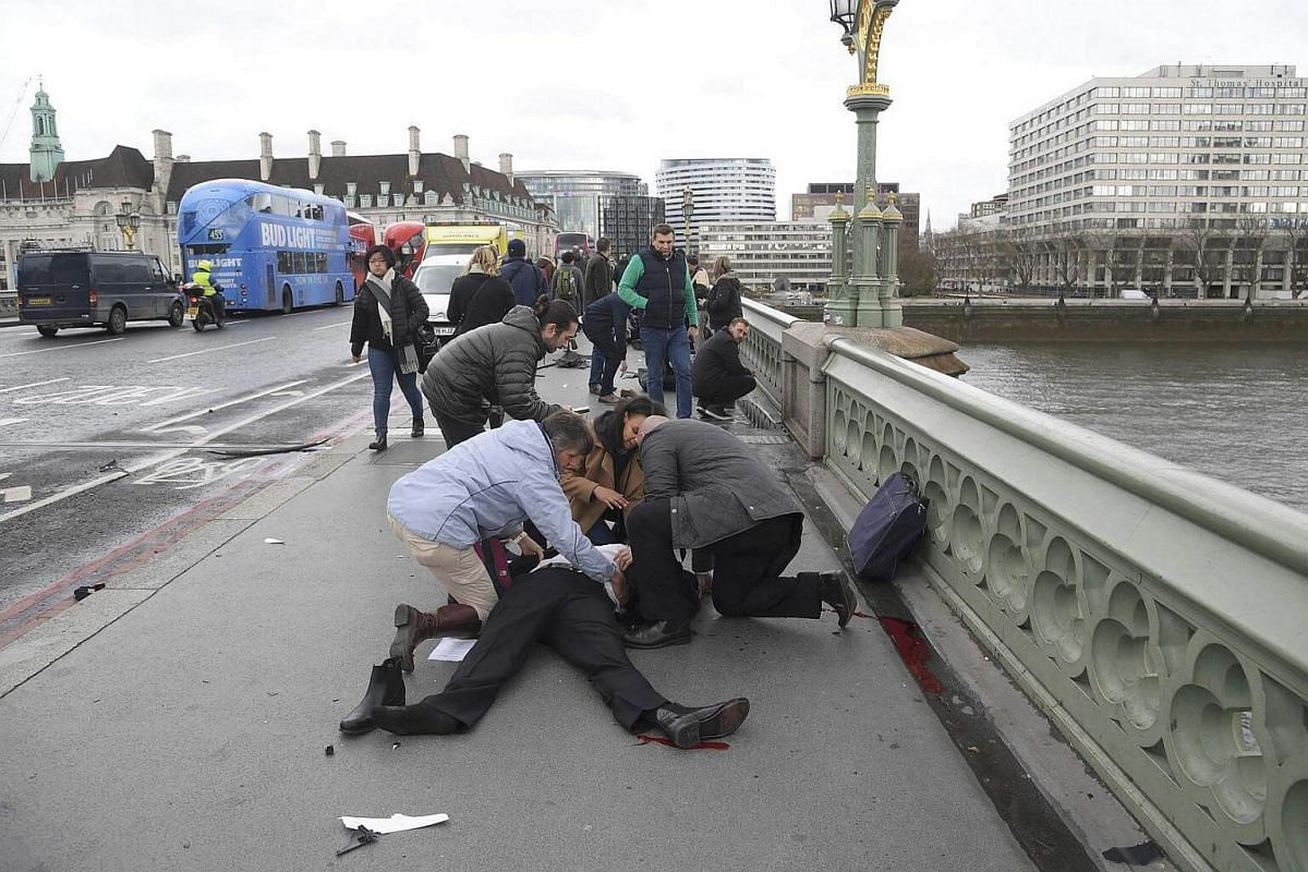 Injured people are assisted after an incident on Westminster Bridge.