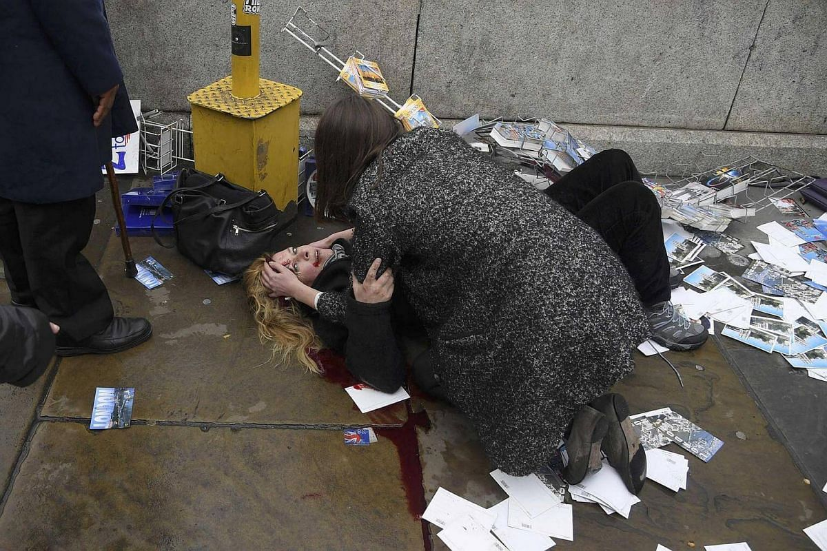 A woman lies injured after the incident on Westminster Bridge.