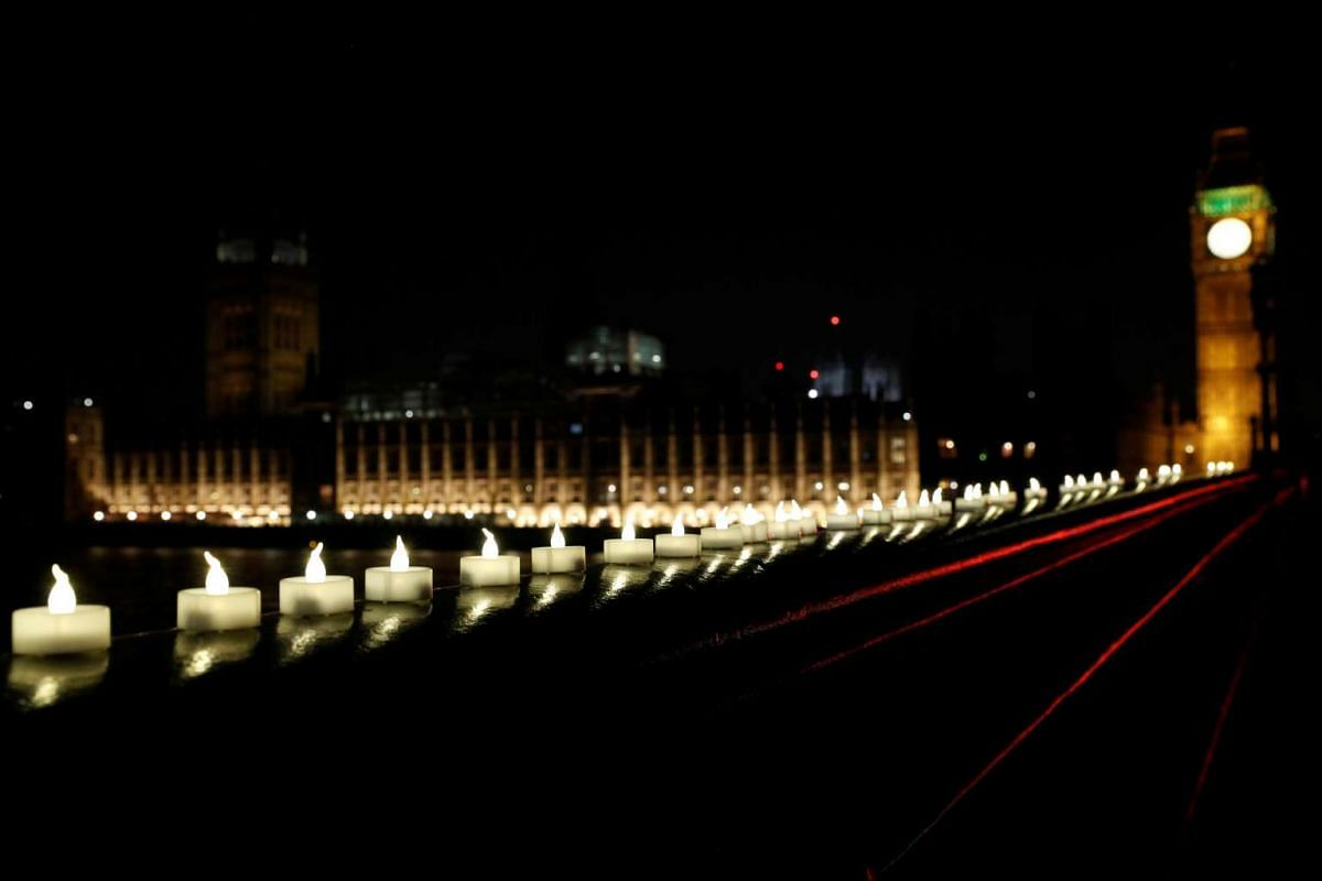Candles burning on Westminster Bridge the day after an attack in London, Britain, on March 23, 2017.