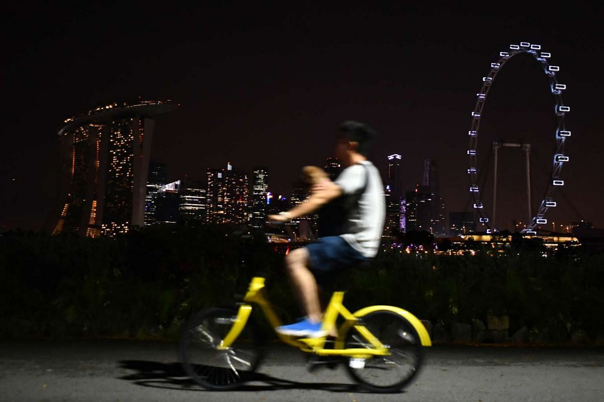 Cyclist cycling at Gardens by the Bay (Bay East) during Earth Hour at 9.08pm on March 25, 2017.