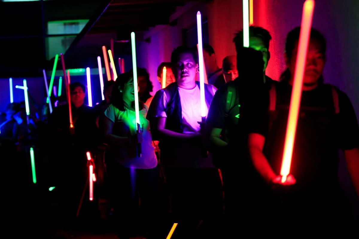 Star Wars enthusiasts raise their lightsabers in salute to Earth Hour  in metro Manila in the Philippines.