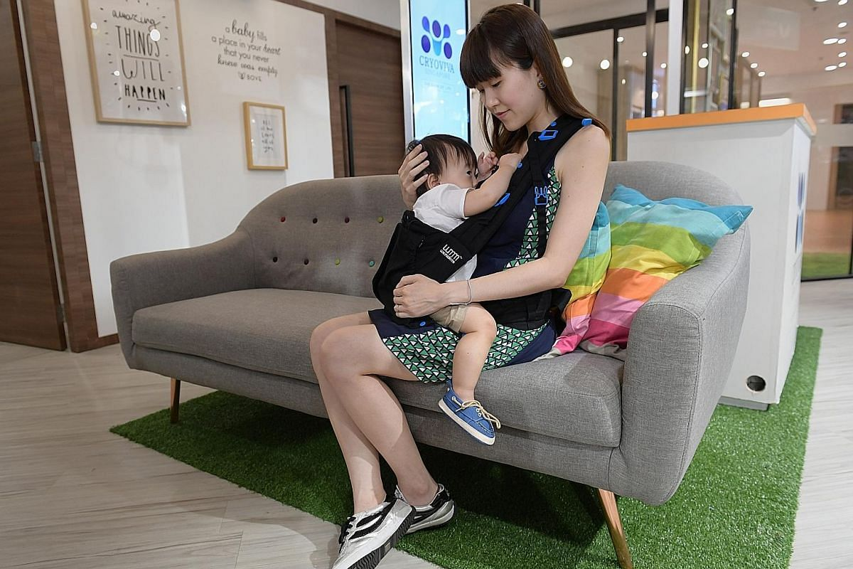 Lifestyle blogger Janice Leong, who gave birth less than two weeks ago, wears a side-access breastfeeding garment by Mothers en Vogue. Ms Cindy Gan, who runs a content marketing business, breastfeeding her son Leroy in a nursing outfit from Bove by S