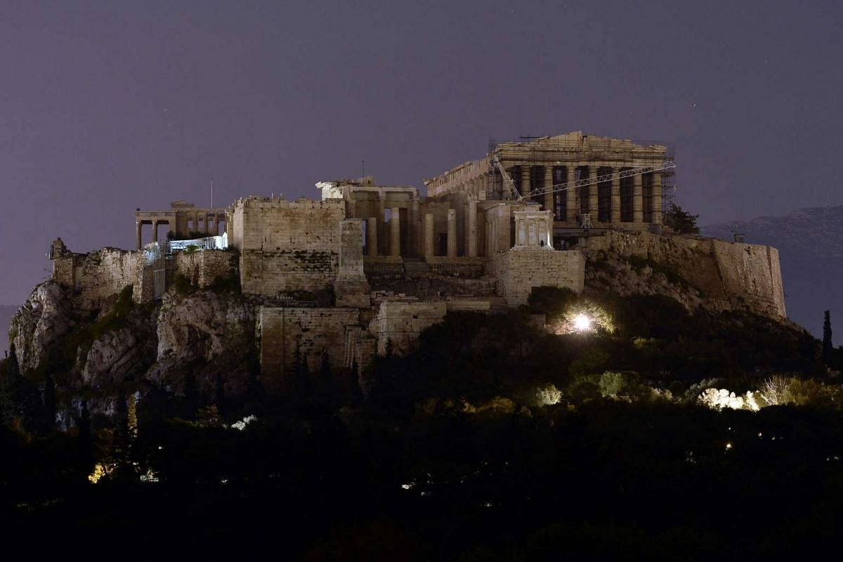 The ancient Acropolis in seen in its ancient state - with lights off - during the Earth Hour in Athens, Greece.