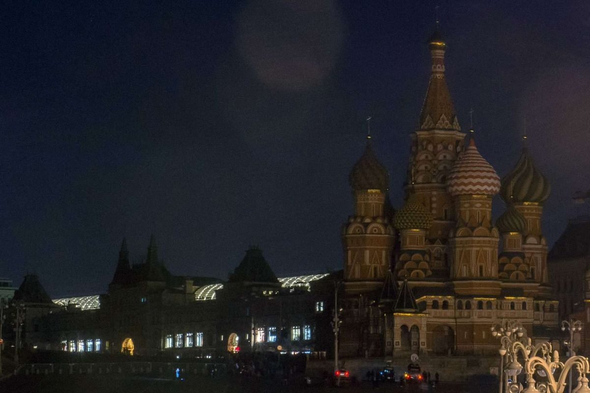 St.Basil's Cathedral and the GUM department store in Moscow are submerged into darkness for Earth Hour.