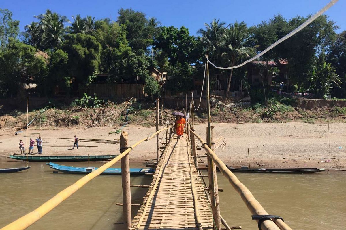 The bamboo bridge over Nam Khan river is built during the dry season.