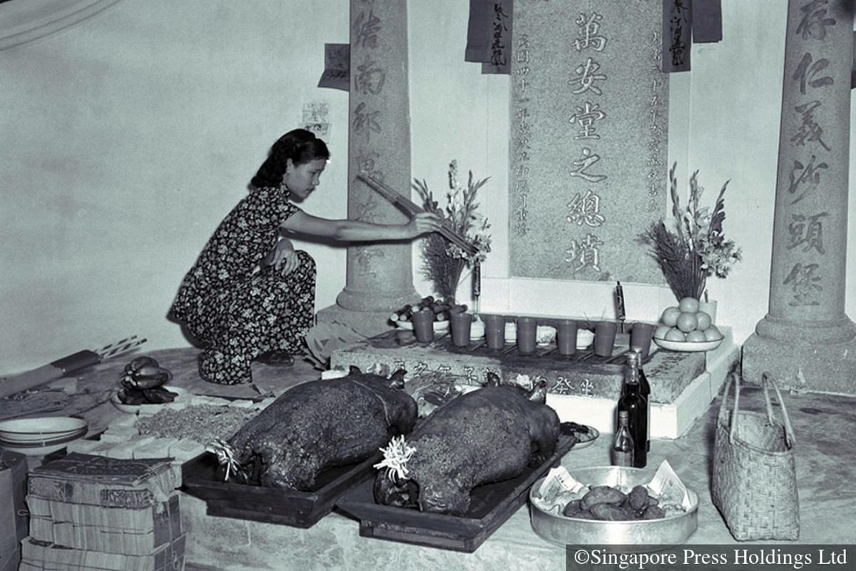 1952: The women folk usually see to the entire elaborate preparation of food and wine. In bygone days, firecrackers were also set off as worshippers laid out offerings before the interred remains of their ancestors. Where it happened to be a joint wo