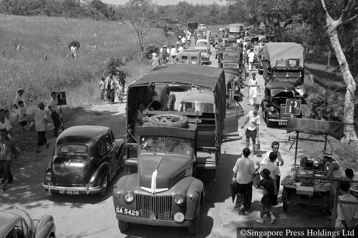 1957: The scene at Bukit Timah cemetery is also played out at chinese cemeteries throughout the island during the Qing Ming period where serious jams are seen at normally-quiet burial grounds.