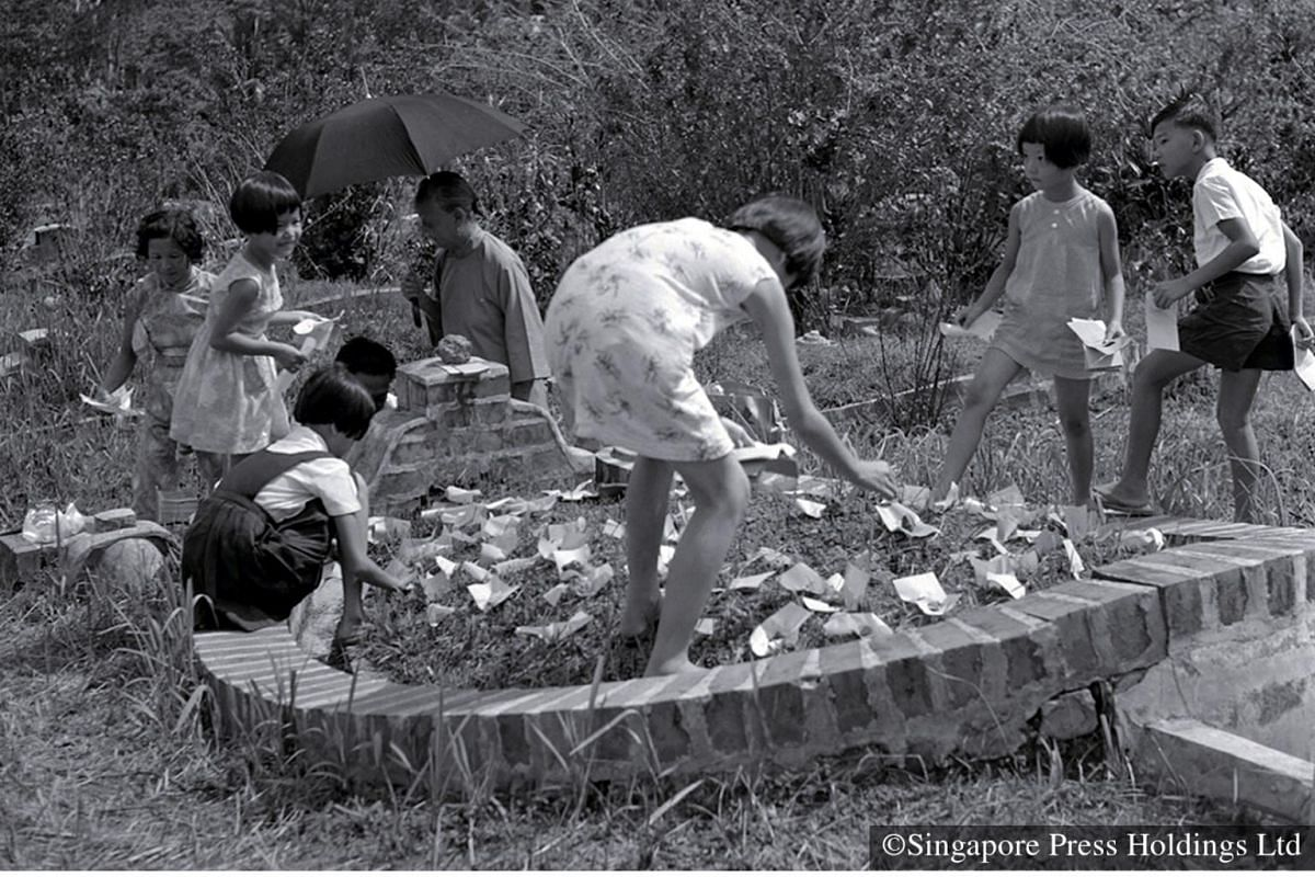 1970: Qing Ming rituals are really about reconnecting with one another as families honour the memory of their predecessors, as seen here at the Whitley Road cemetery. Involving the young ensures that the Qing Ming spirit is passed on from generation
