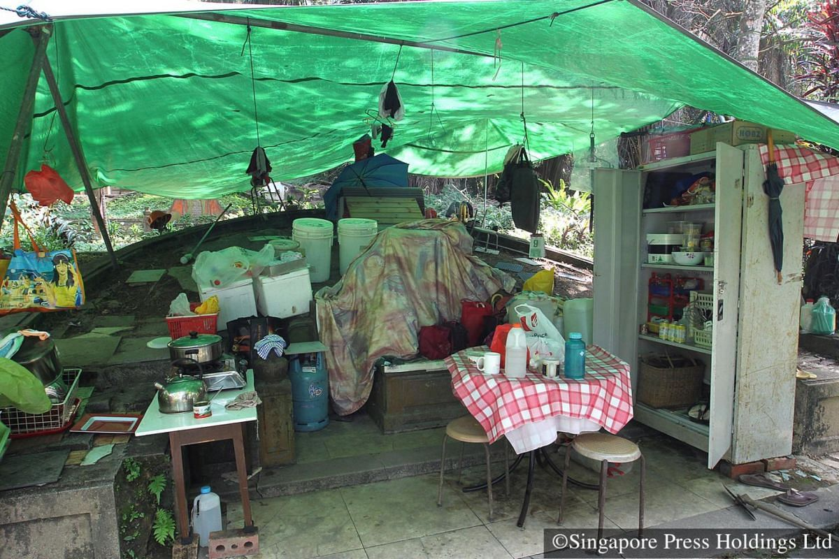 2011: Makeshift shelters and facilities for cooking food are set up at Bukit Brown cemetery by grave workers. For a small fee, the tomb-keepers clean and maintain the graves and help families look for the tombs of their relatives.